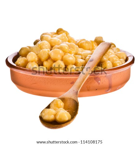 Chickpeas in a bowl made of clay with a wooden spoon, on white background . - stock photo