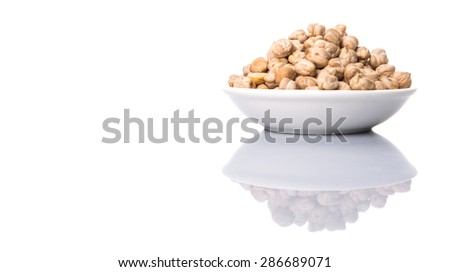 Chickpeas in a white bowl over white background - stock photo