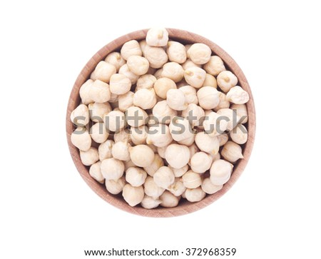 Chickpeas in a wooden bowl isolated on white background, top view - stock photo