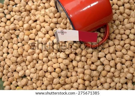 Chickpeas or Garbanzo Beans With Malta Flag - stock photo
