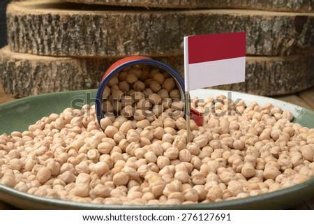 Chickpeas or Garbanzo Beans With Monaco Flag - stock photo