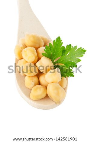 chickpeas over wooden spoon on white background. - stock photo