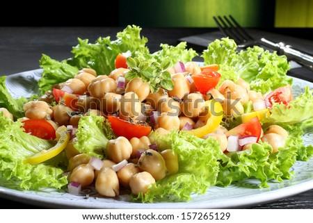 chickpeas salad   green background - stock photo