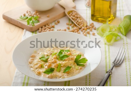 Chickpeas with paprika, cream sauce, sprinkled with herbs, organic chickpeas - stock photo