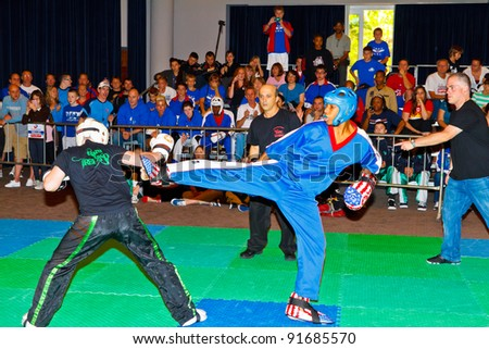 CHICLANA DE LA FRONTERA, SPAIN-NOV 05: Unidentified players compete in the 3rd World Karate and Kickboxing Council championship  on Nov 05, 2011, in Chiclana de la Frontera,  Spain