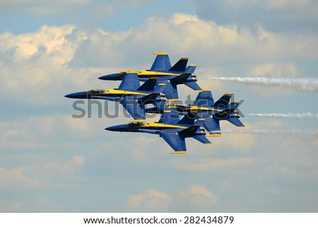 CHICOPEE, MA, USA - MAY 17: Navy Blue Angels Aerobatic flight demonstration team F/A-18 Hornet perform diamond formation, Westover Air Reserve Base on May 17, 2015 in Chicopee, Massachusetts, USA. - stock photo