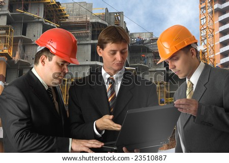 Chief and two builders with laptop