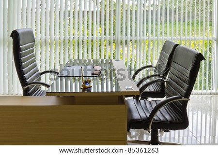 Chief executive or manager office with desk and armchairs, office interior - stock photo