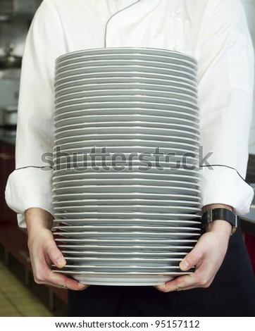 Chief holding a Stack of Plates - stock photo