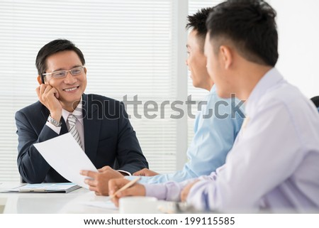 Chief listening to the business ideas of his employees