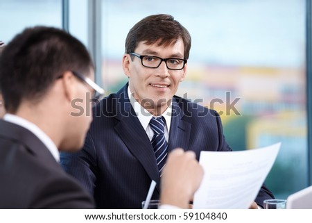 Chief of staff listens carefully to the meeting - stock photo