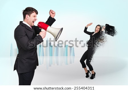 Chief shouting through megaphone on the  businesswoman on light background - stock photo
