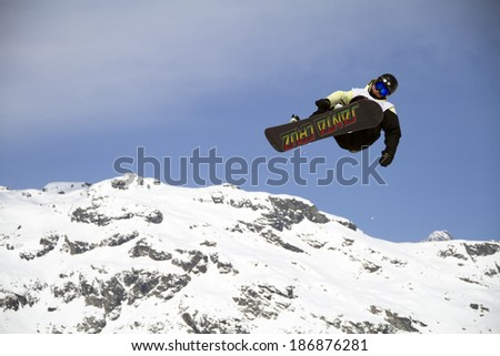 Chiesa in Valmalenco, IT - MAR 30:  snowboarder compete in the Fis freestyle junior world championships 2014  Snowboard Slopestyle event in Chiesa Valmalenco, IT on March 30, 2014 - stock photo