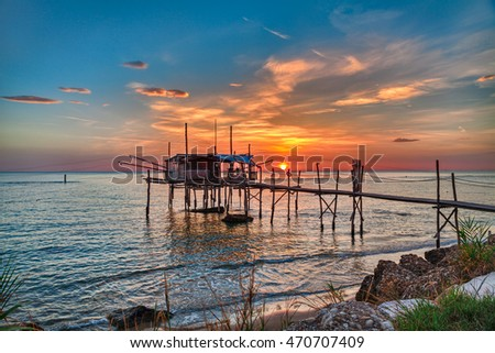 Chieti, Abruzzo, Italy: Adriatic sea coast at sunrise with an ancient fishing hut trabocco, the typical mediterranean wooden pilework