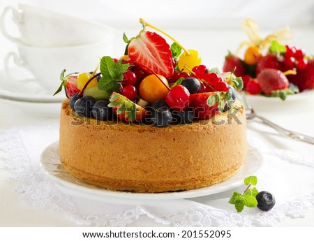 Chiffon cake with summer berries and cream. - stock photo