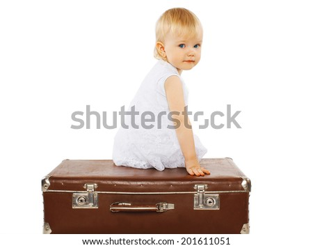 Child and a suitcase, family travel - concept - stock photo