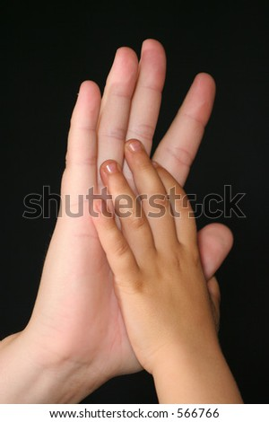 Child and adult hands - stock photo