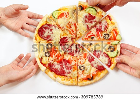 Child and adult hands take pieces of a flavored pizza - stock photo