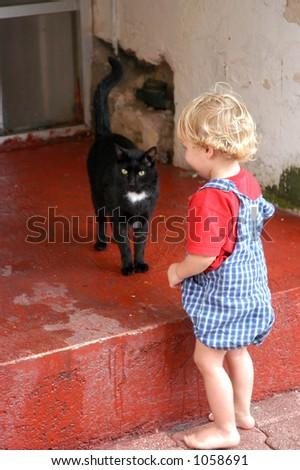 Child and Black Cat - stock photo