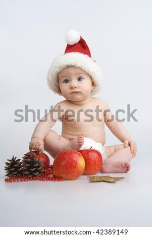 Child and Christmas decoration,on white background. - stock photo