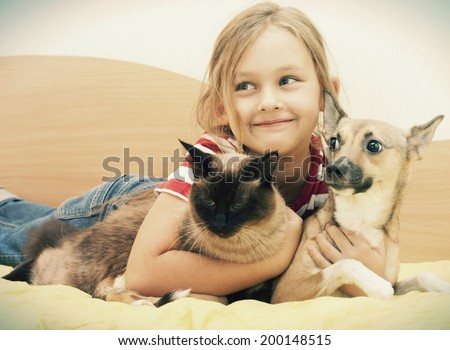 child and dog and cat - stock photo