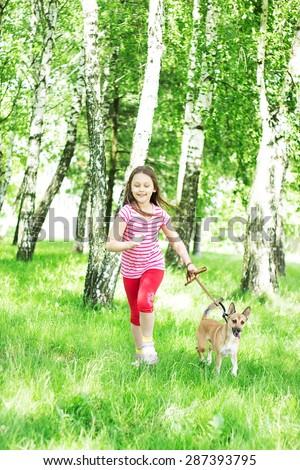 child and dog running  - stock photo