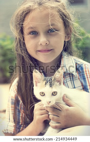 child and kitten - stock photo