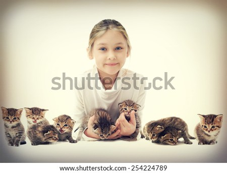 child and kittens - stock photo