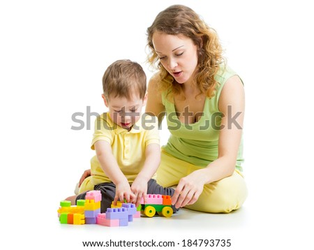 child and mom play with block toys - stock photo