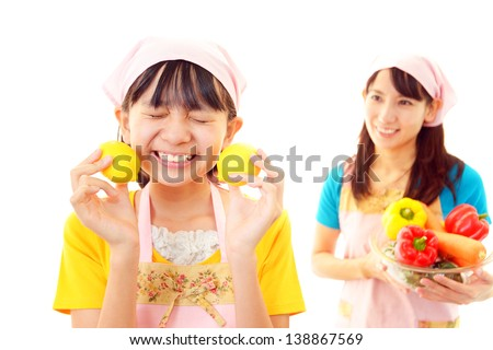 Child and mother cook