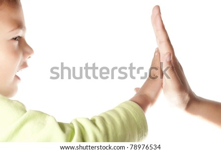 Child and  mother giving a High Five on white background - stock photo