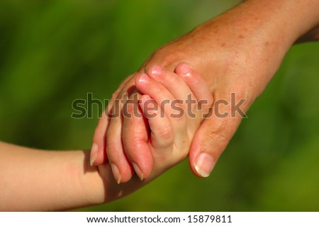Child and mother holding hands