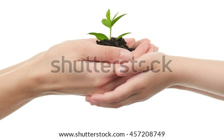 Child and mother holding soil and plant isolated on white