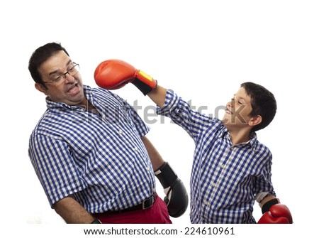 child and parent with boxing gloves - stock photo