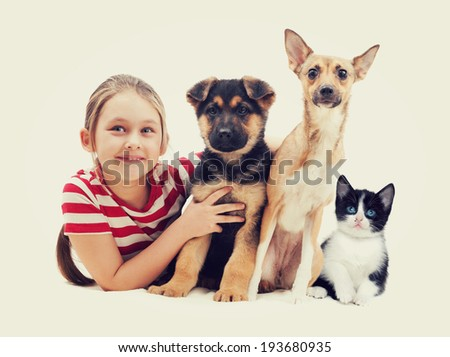 child and pets  - stock photo