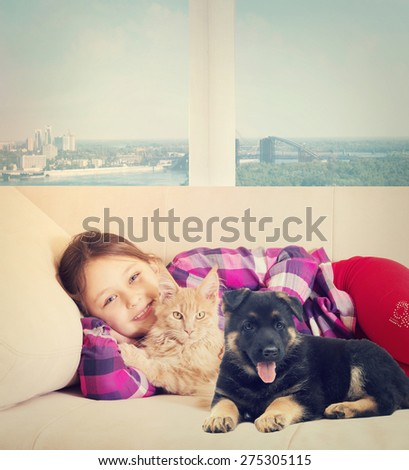 Child and puppy and kitten - stock photo