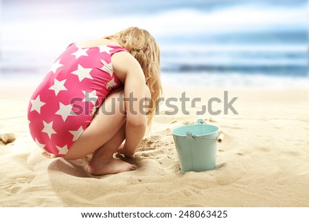 child and sand on the beach and summer time  - stock photo