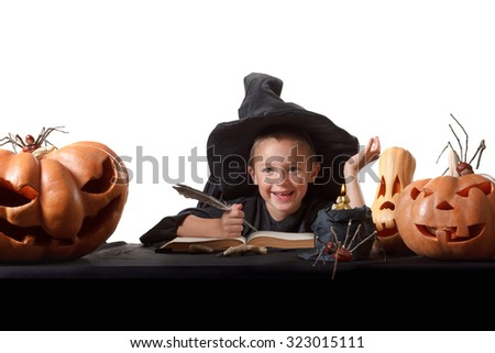 Child and spooky Halloween pumpkins with magic book, candle, spider. Isolated on white background - stock photo