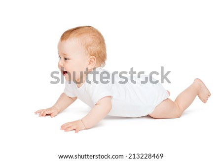 child and toddler concept - crawling curious baby looking up
