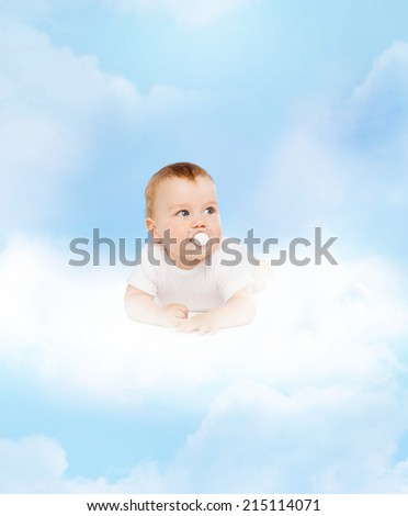 child and toddler concept - smiling baby lying on cloud with dummy in mouth - stock photo