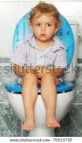 Child and toilet - stock photo