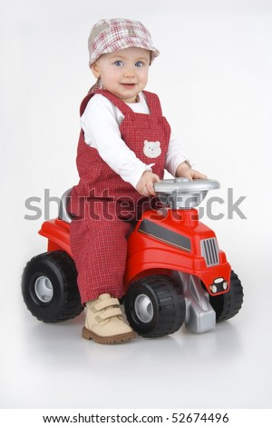 Child and toy - car,little girl governs toy - car on white background. - stock photo