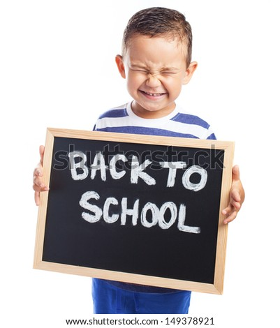 child angry holding a blackboard back to school on a white background - stock photo