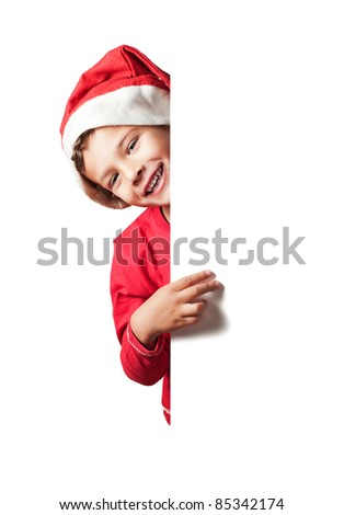 Child as Santa Claus holding a white blank sign - stock photo