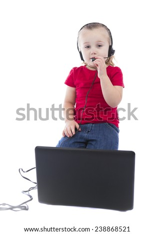 child at the computer on a white background