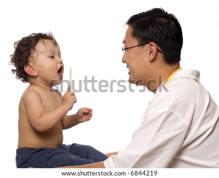 Child at the doctor, playing with medical equipment. - stock photo