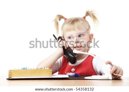 child at the table with pnone - stock photo