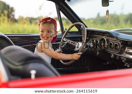 child at the wheel
