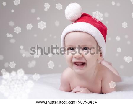 child baby in red Santa's hat - stock photo