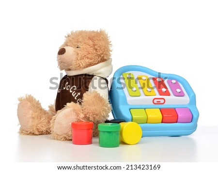 Child baby toys collage with colorfull paints, teddy bear xylophone toy on a white background - stock photo